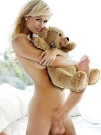 Sexy blonde posing with a favorite stuffed toy